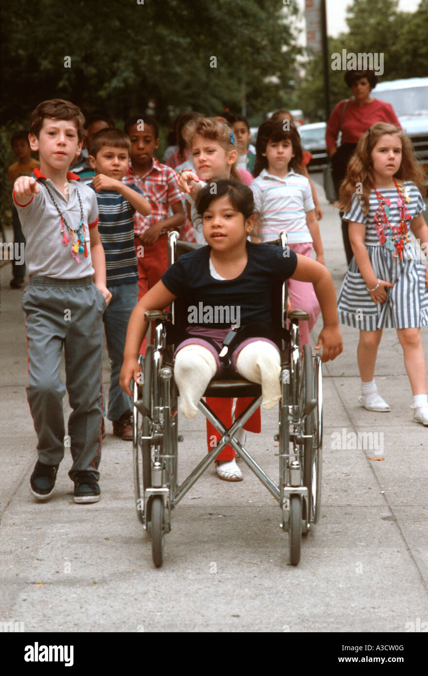 Mainstreamed disabled child on a field trip with her classmates in Brooklyn New York - Stock Image