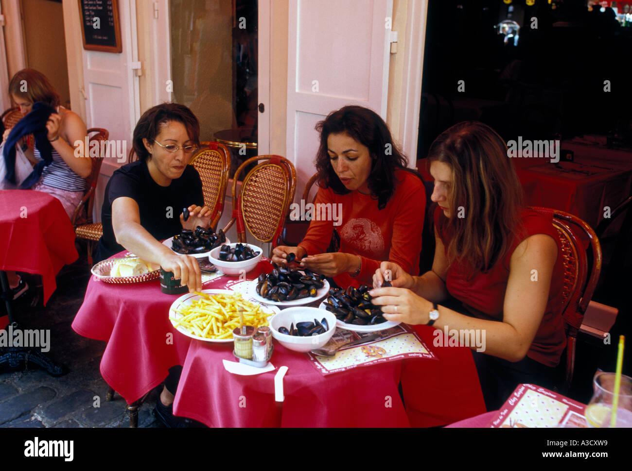 French People Women Eating Mussels At Restaurant In Place Du Tertre Montmartre District Paris Ile De France Region Europe