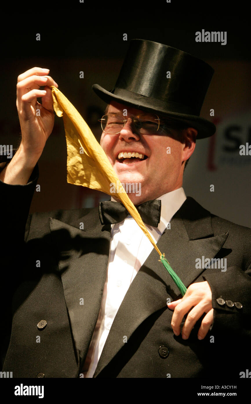 Performance of Peer Steinbrueck which is manipulated by a magician behind his back - Stock Image