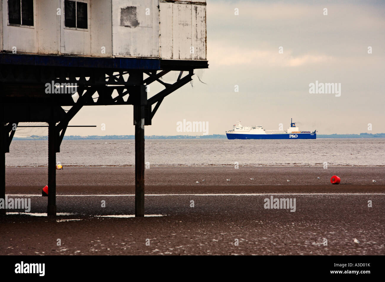 P&O ferry in the Humber Estuary off Cleethorpes, Lincolnshire, England, UK - with the per in foreground - Stock Image