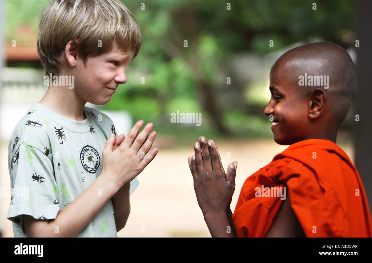 Close up portrait of young student buddhist monk in traditional close up portrait of young student buddhist monk in traditional robes smiling and happy greeting caucasian friend sri lanka m4hsunfo
