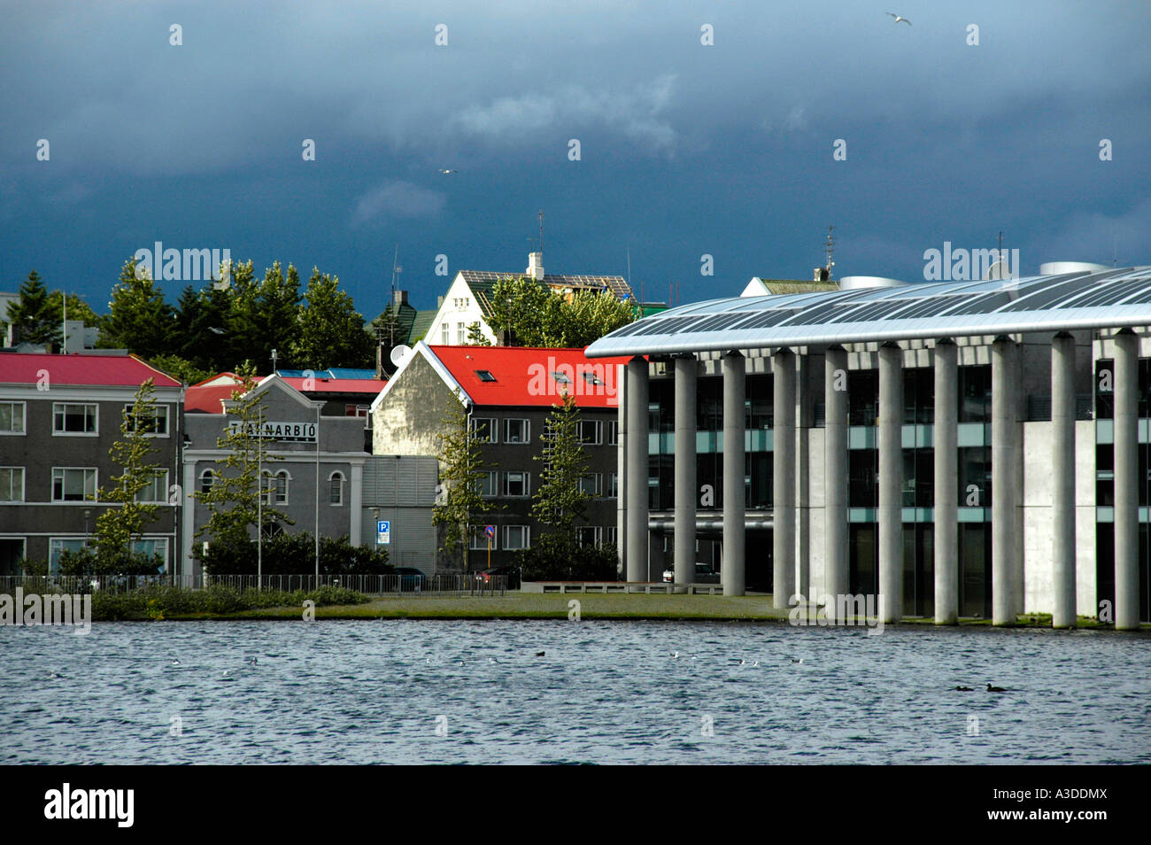 Modern cityhall at lake Tjoernin Reykjavik Iceland Stock Photo