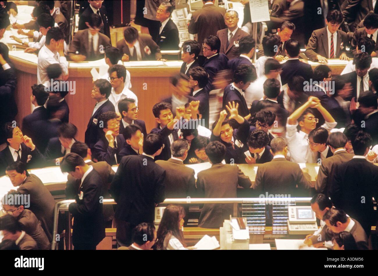 fe46c8191e Japan Tokyo stock exchange trading floor crowds business - Stock Image