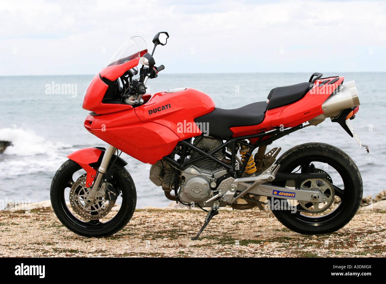 Ducati Multistrada on the beach - Stock Image