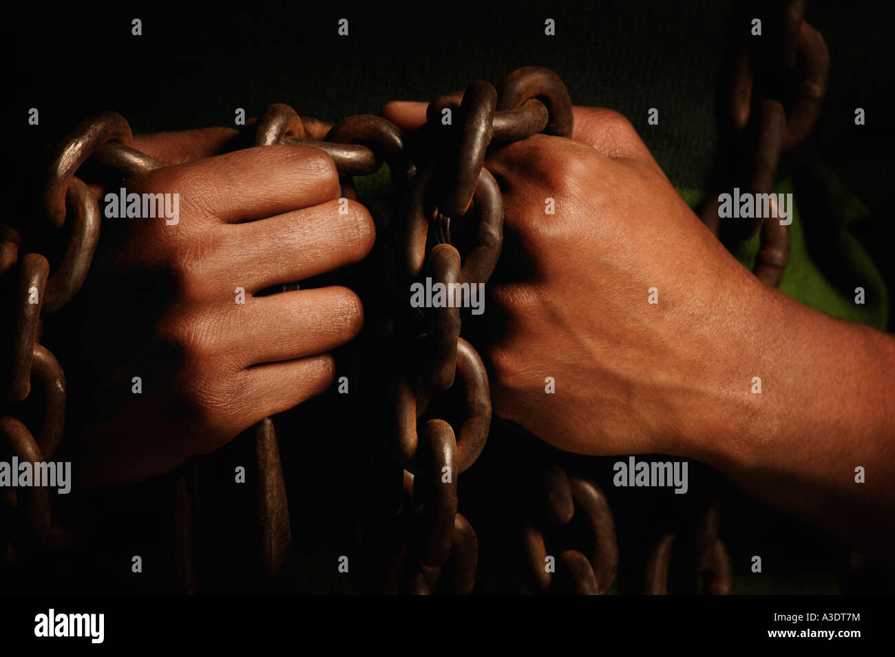 Person bound in chains Stock Photo