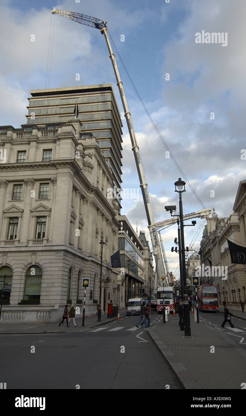 Lorry mounted telescopic crane at work in Pall Mall London Stock Photo