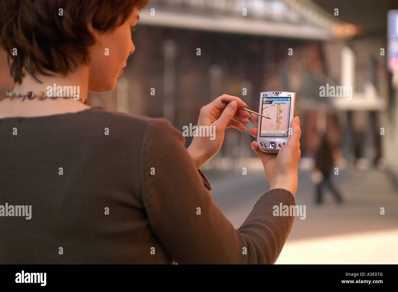 Pedestrian with navigation system - Stock Image