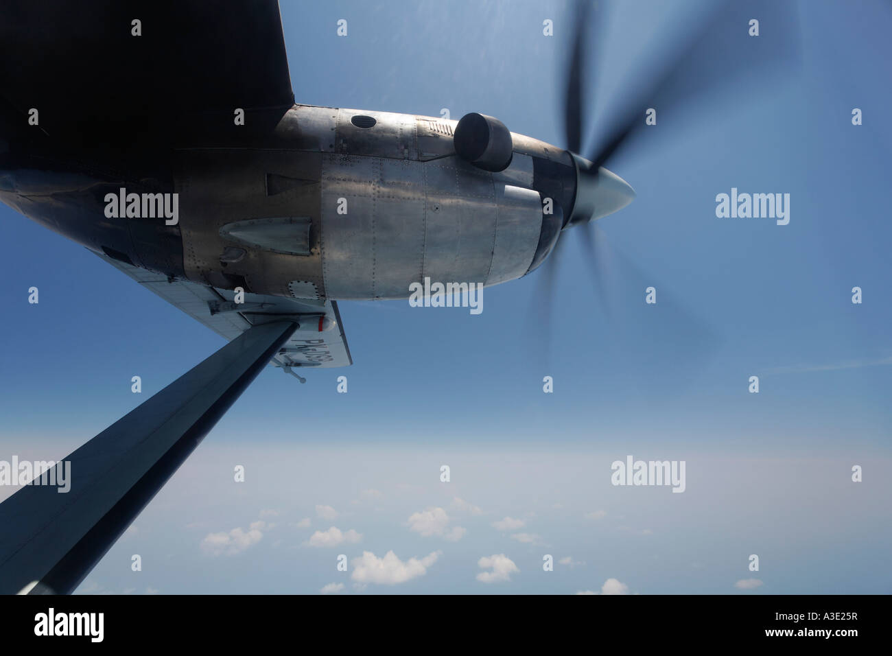 View from turbo-prop airplane at cloud cover - Stock Image