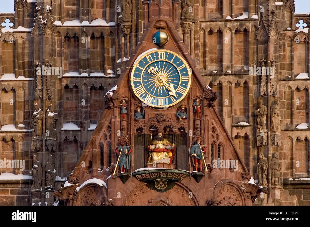 The clock with the 'Maennleinlaufen' of St.Mary´s Church, central market Nuremberg, Bavaria, Germany - Stock Image