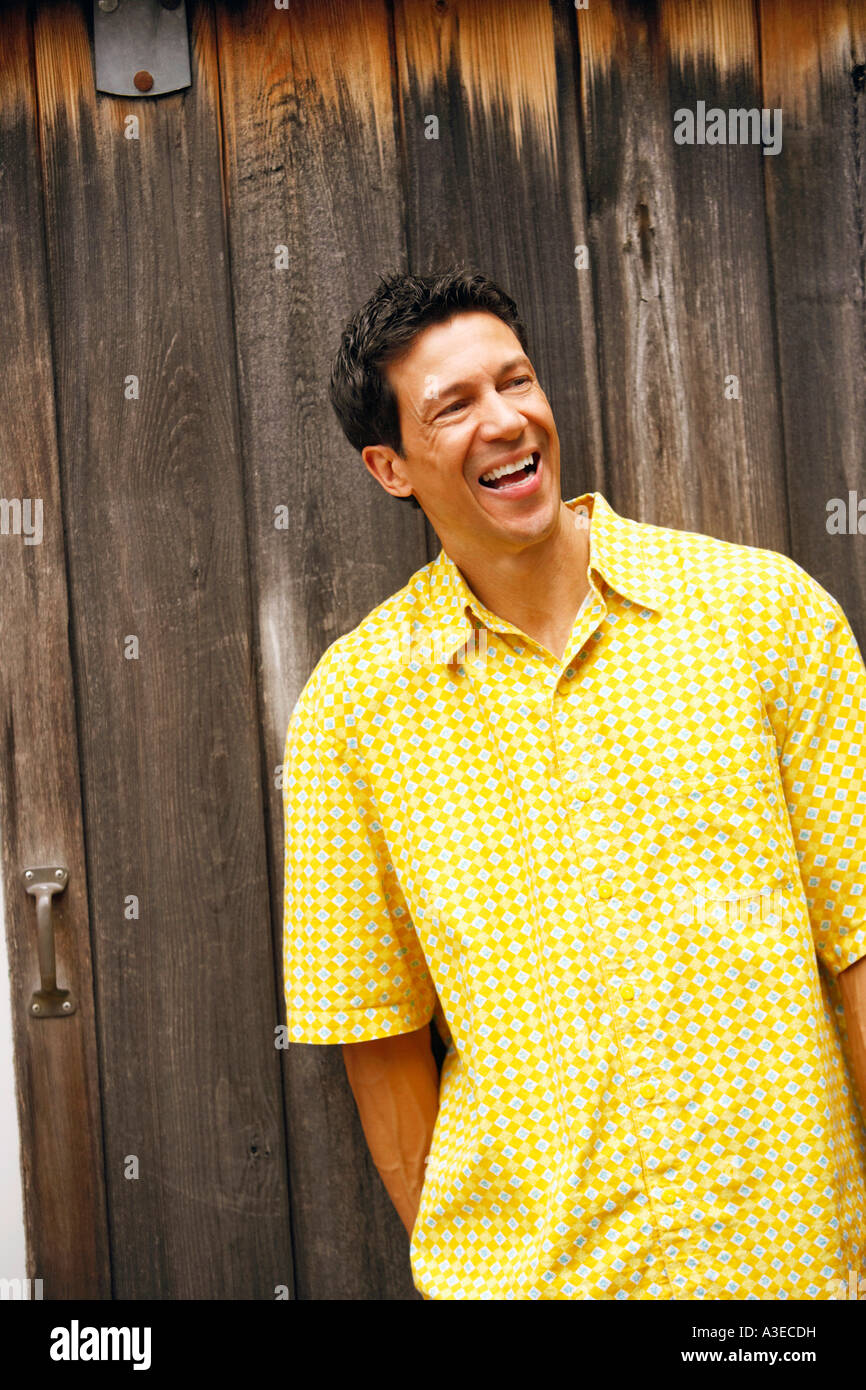 Close-up of a mature man standing and smiling - Stock Image