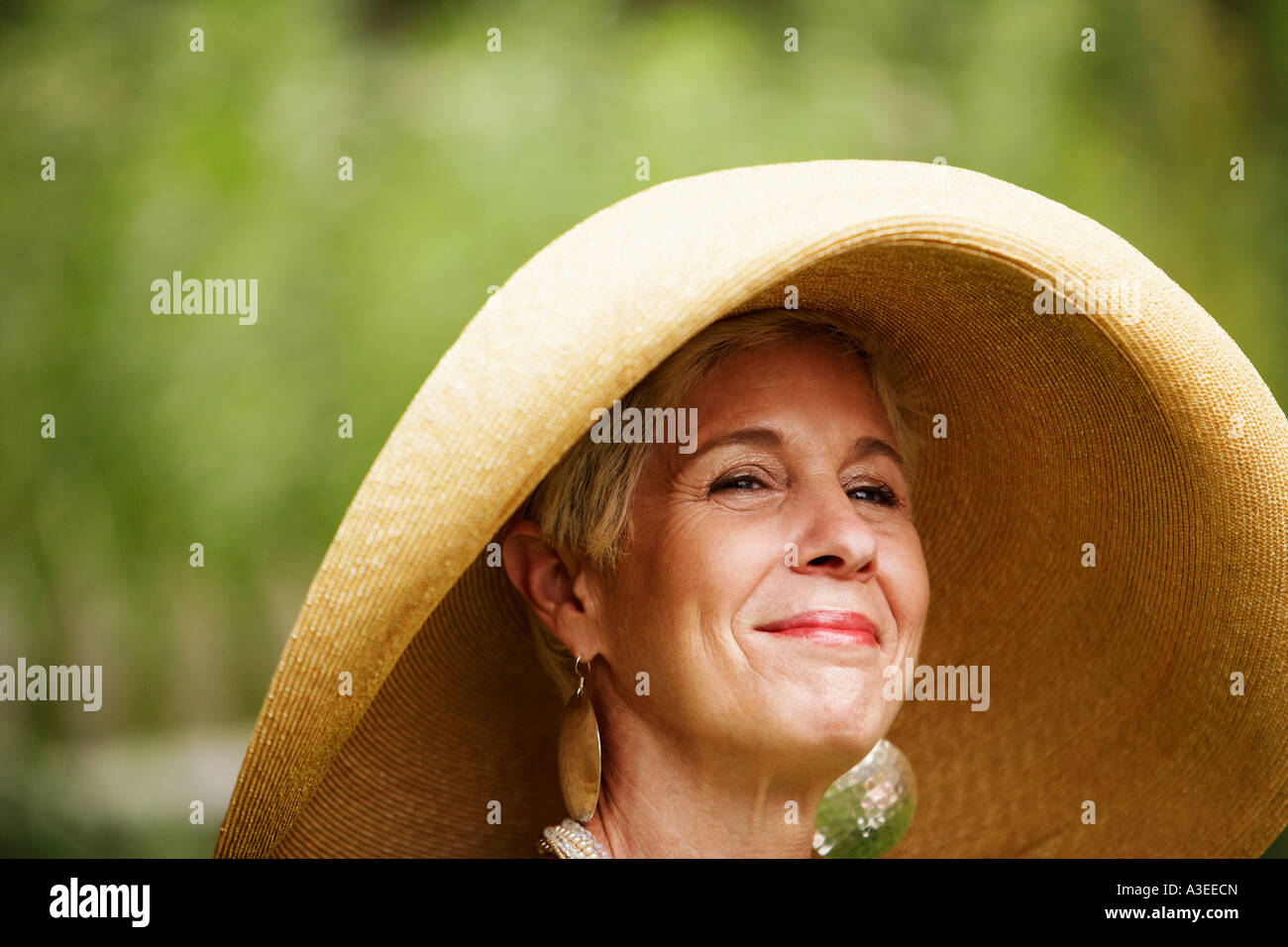 Close-up of a senior woman looking away - Stock Image