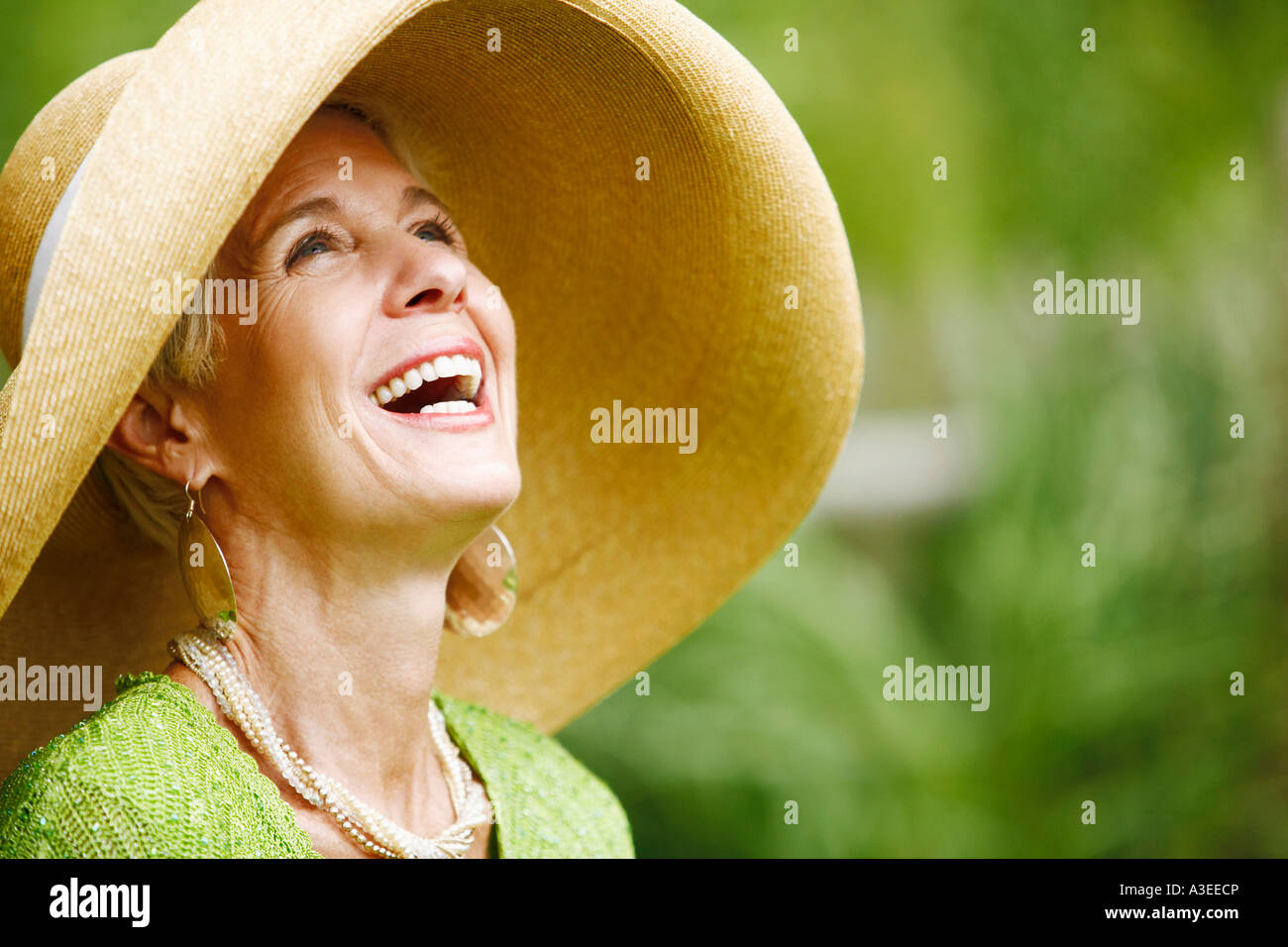 Close-up of a senior woman laughing - Stock Image