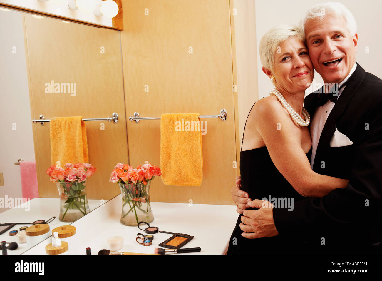 Portrait of a mature man and a senior woman embracing each other in the bathroom Stock Photo