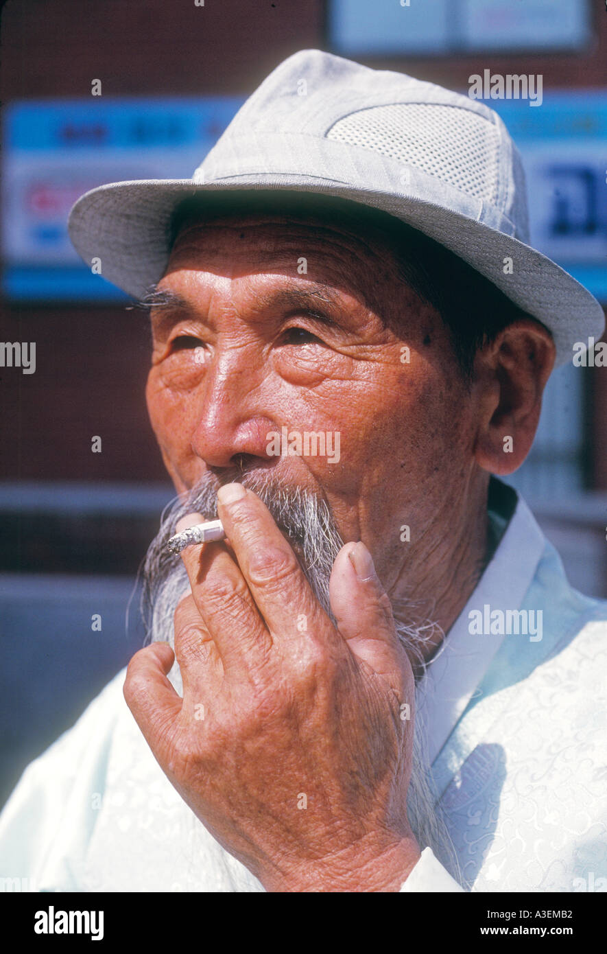 Chejudo cheju island south korea south korea asia asian oriental travel lifestyle destination holiday old man adult smoke smokin - Stock Image
