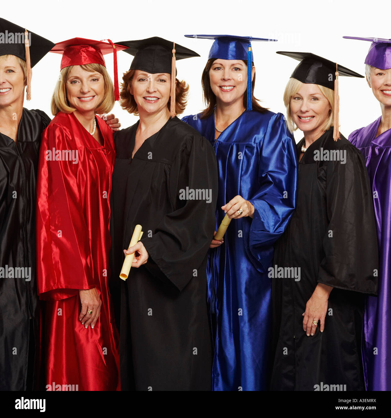Portrait of a group of mature women wearing graduation gowns Stock ...