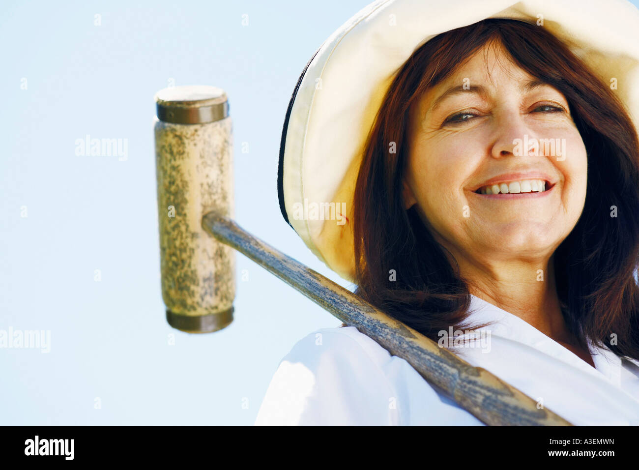 Low angle view of a mature woman holding a croquet mallet Stock Photo