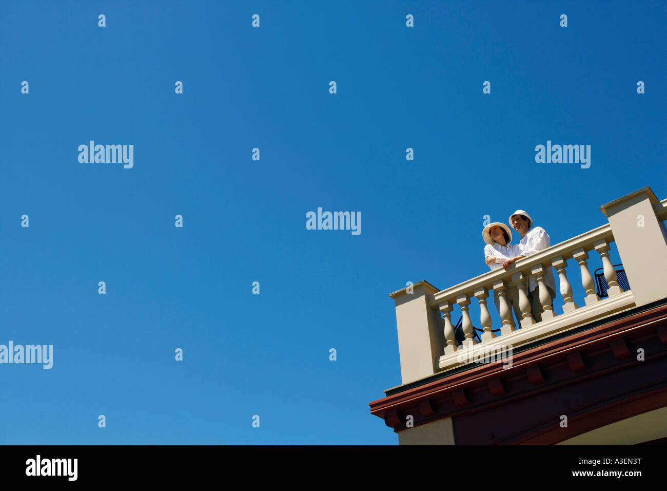 Low angle view of a mid adult couple standing on a terrace Stock Photo