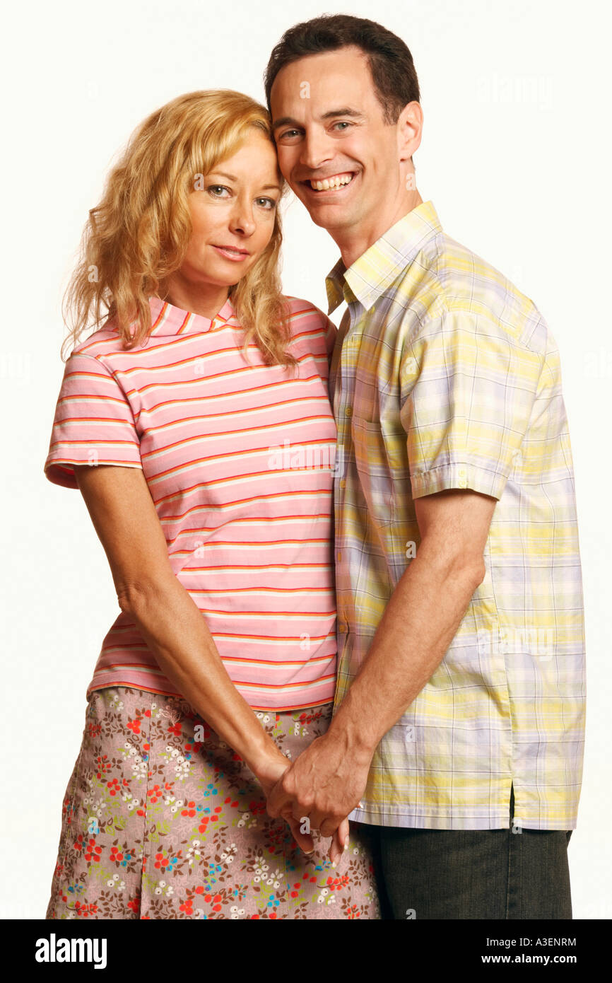 Portrait of a mature couple standing with holding hands - Stock Image