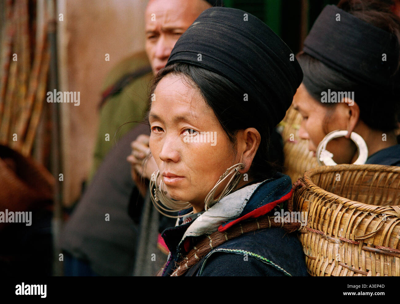 Portrait of a woman of the Hmong Tribe in traditional dress at the market in SaPa Northern Vietnam - Stock Image