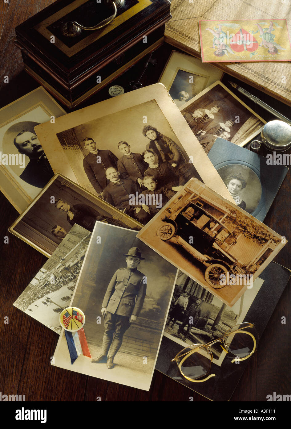 Photo editorial pictorial depiction of generic family history from 1800s through WW1 with antique photos related items - Stock Image