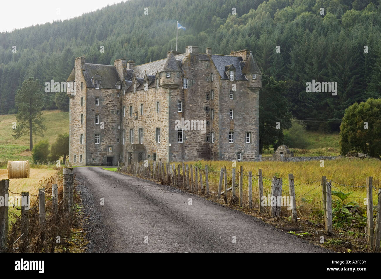 Fence Lined Road Leading to Castle Menzies Near Weem Scotland - Stock Image