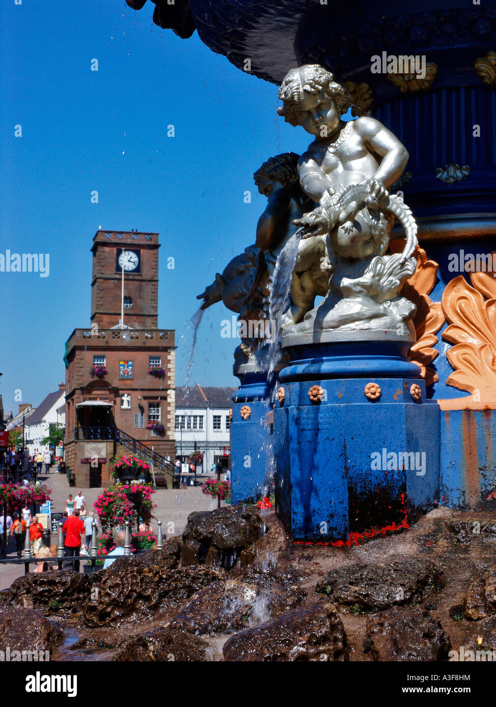 Water fountain with Midsteeple in background High Street Dumfries Galloway Scotland - Stock Image