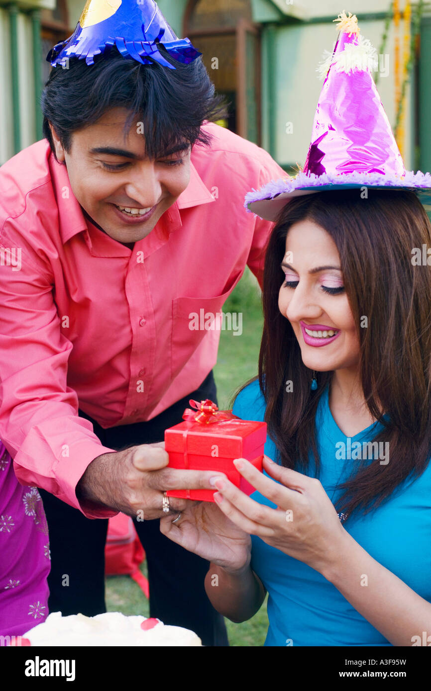 Close Up Of A Young Man Giving Birthday Gift To Woman