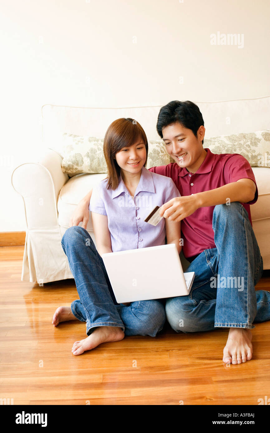 Young couple shopping online with a credit card - Stock Image