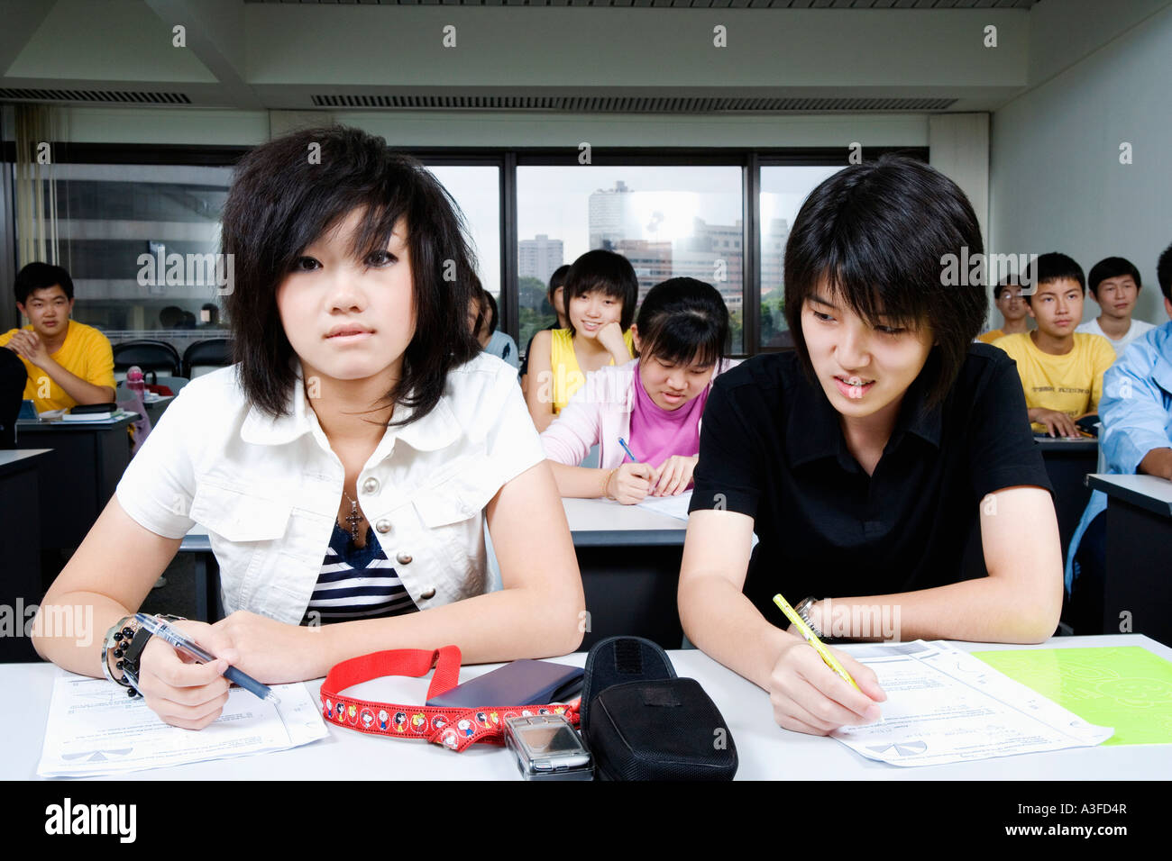 Teenage boy in a classroom - Stock Image