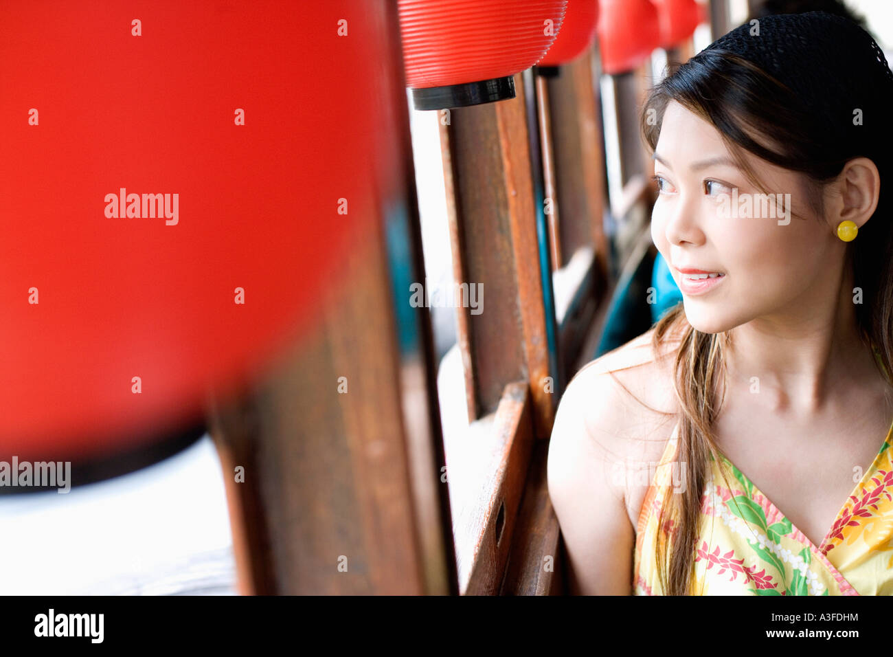 Close-up of a young woman looking out the window of a tourboat Stock Photo