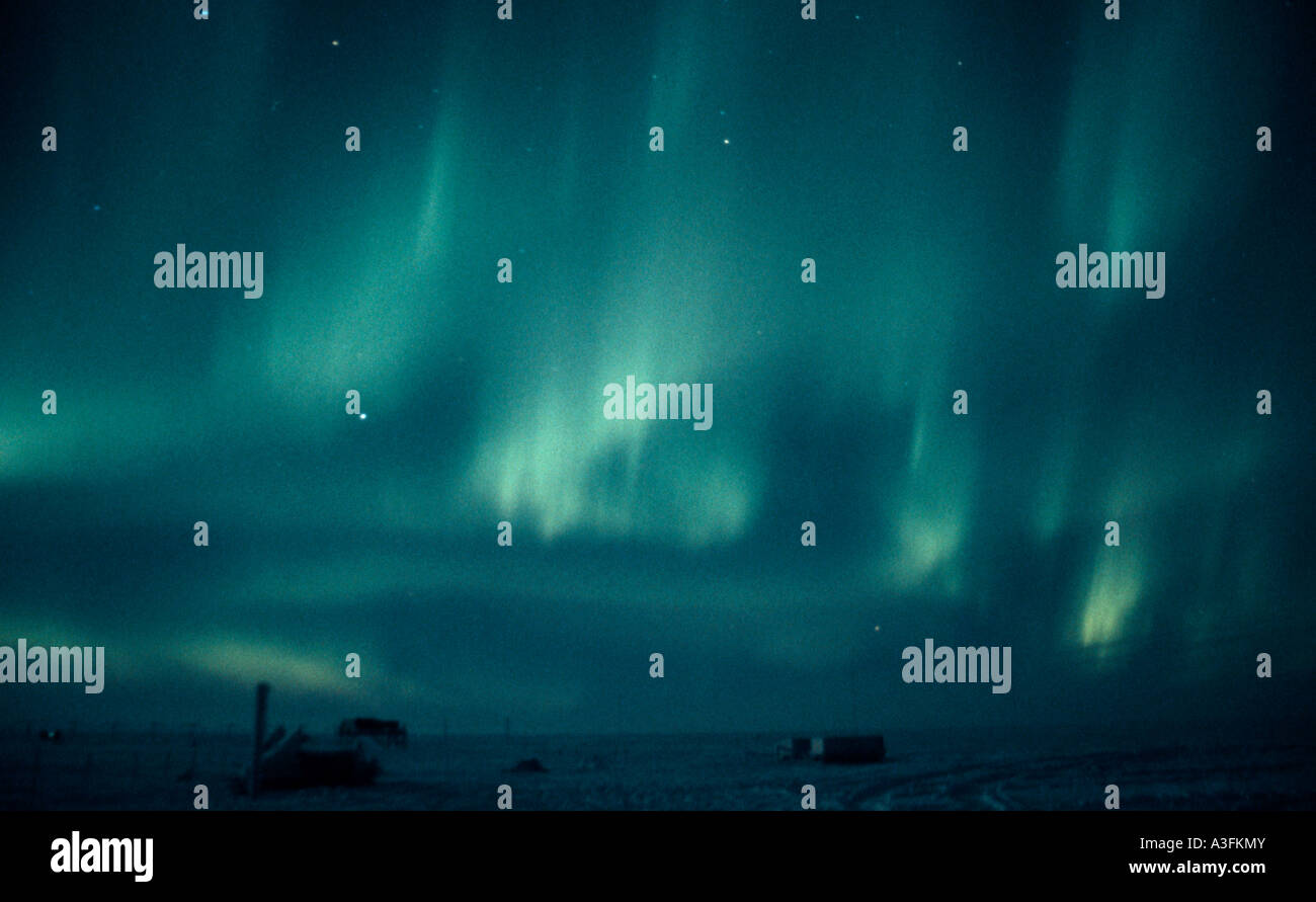 Bright green Southern Lights, Aurora Australis, over Halley Bay research station, Antarctica - Stock Image