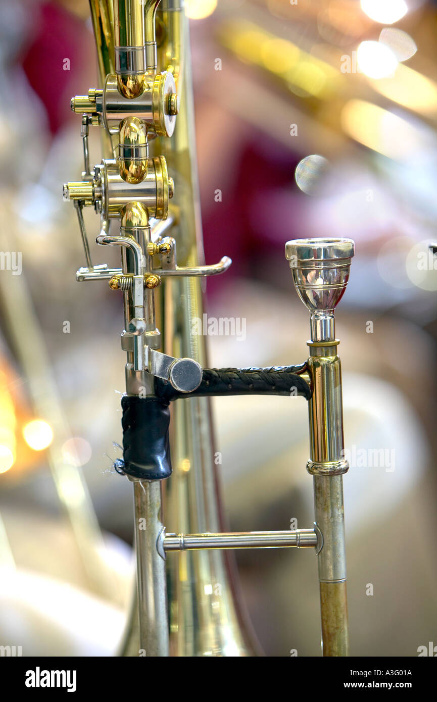 closeup of trombone brass instrument valves and mouth piece - Stock Image