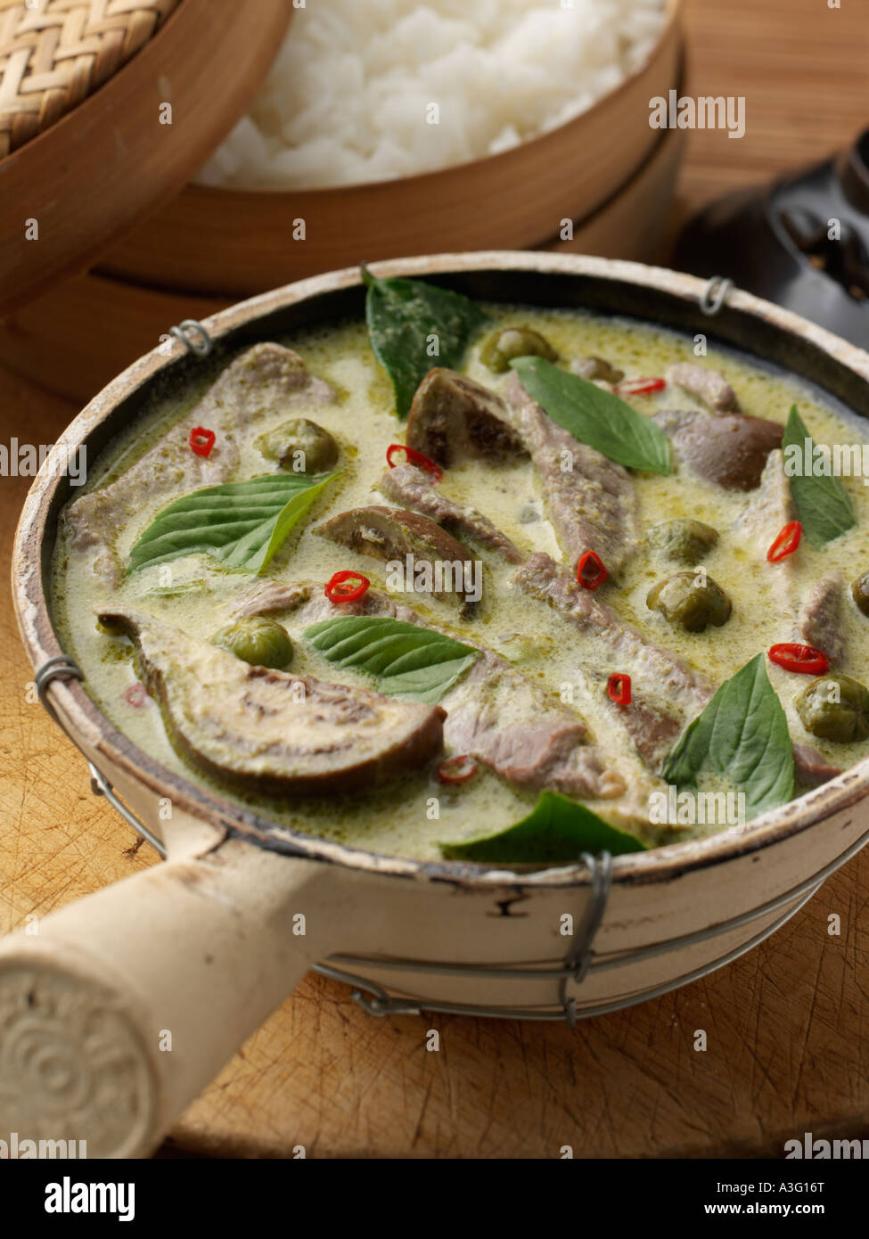Dinner party thai green beef curry stock photos dinner party thai thai beef green curry in a bowl close up editorial food stock image forumfinder Choice Image
