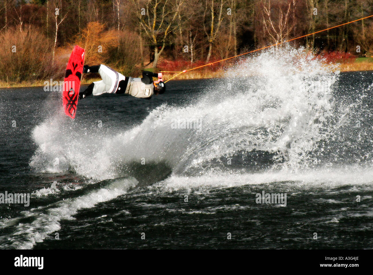 Wakeboarder Dave Ingram doing a back roll at WakeMK in Milton Keynes - Stock Image