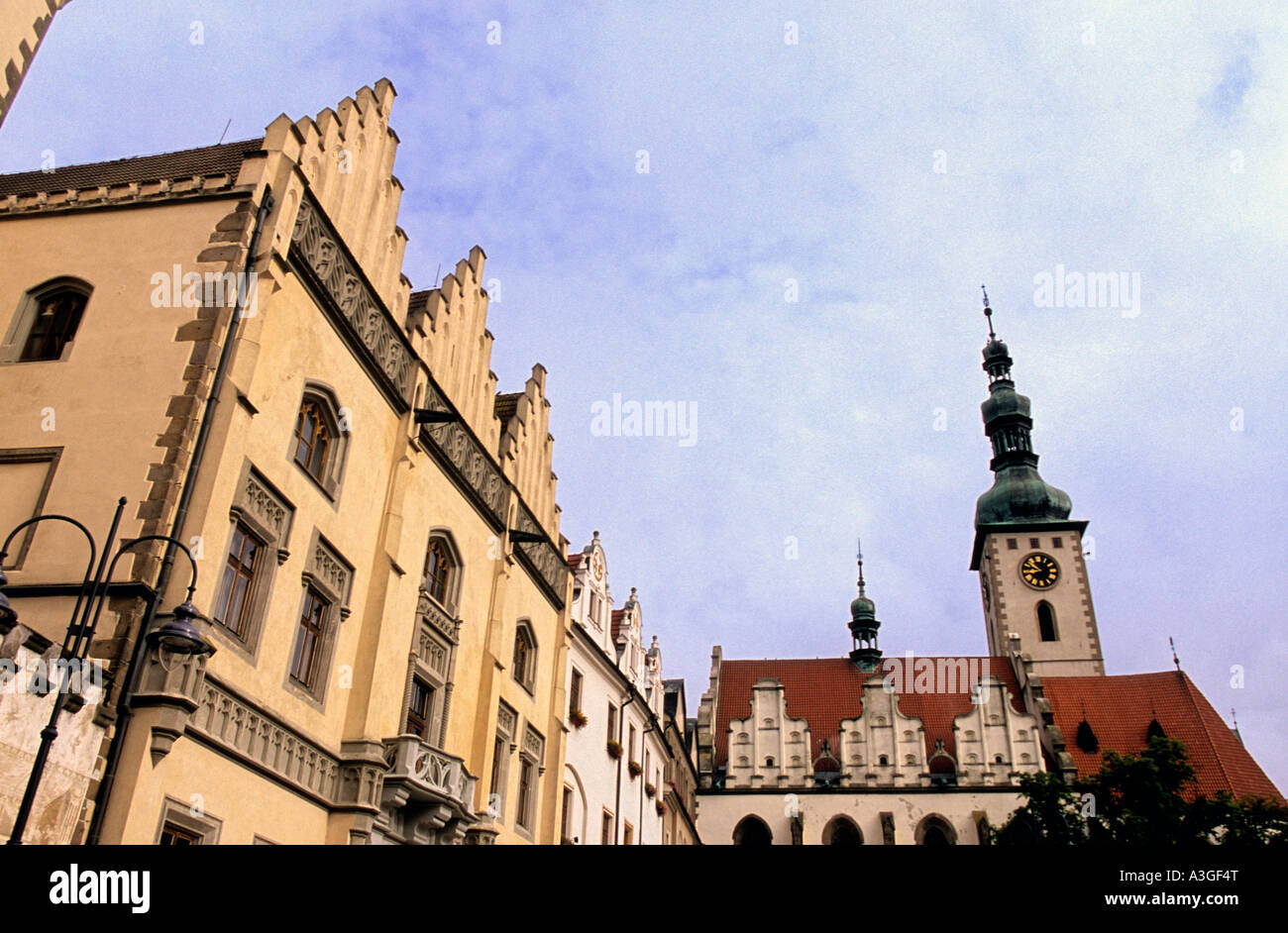 16th century Town Hall w bell tower of Dekansky kostel rising over Zizkovo Namest Central Square Tabor Czech Republic Stock Photo