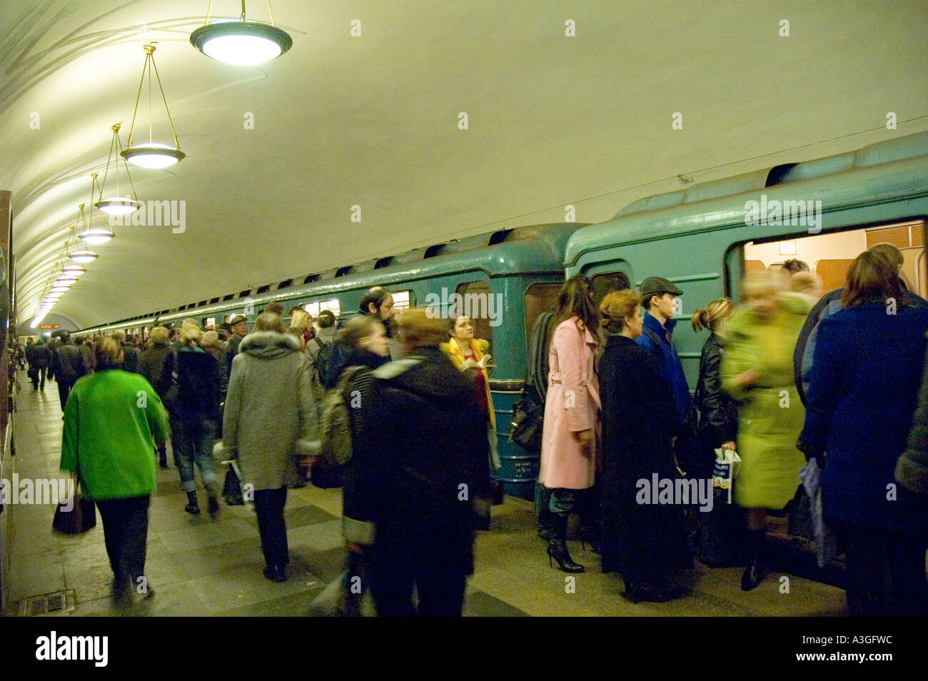 rush hour commuters riding the moscow metro - Stock Image