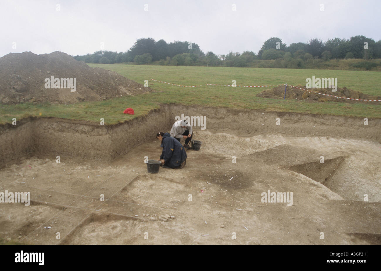 Archaeologists digging on an ancient site near Stonehenge in England Stock Photo