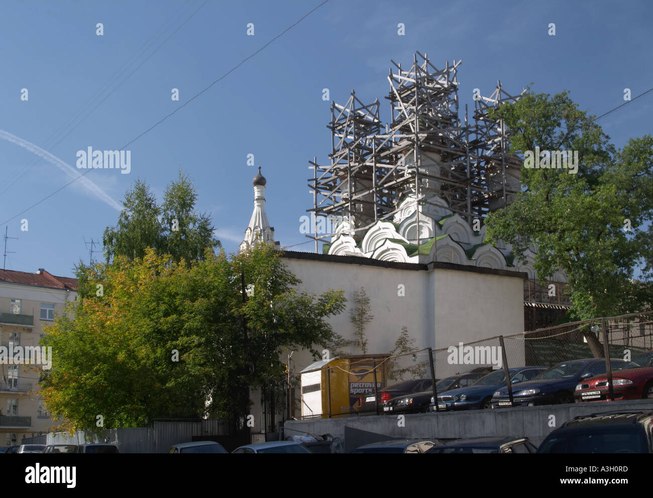 Old Orthodox church in Moscow in scaffolding under reconstruction - Stock Image