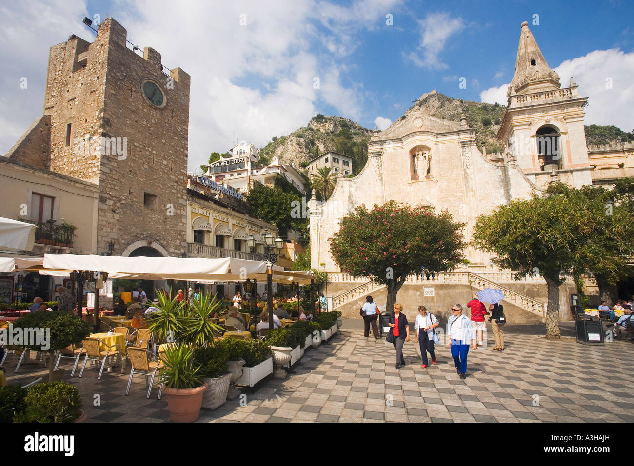 April 9th Square Piazza and  Church of Saint St Augustine with tourists in sun sunshine and pavement cafes Taormina - Stock Image