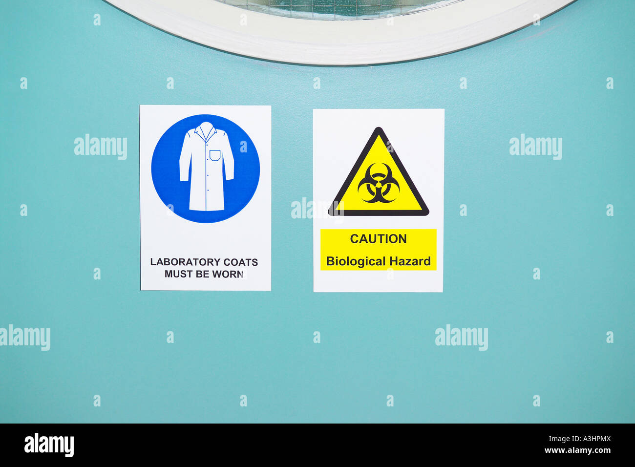 Laboratory Coats must be worn and Biological Hazard sign on door to laboratory - Stock Image