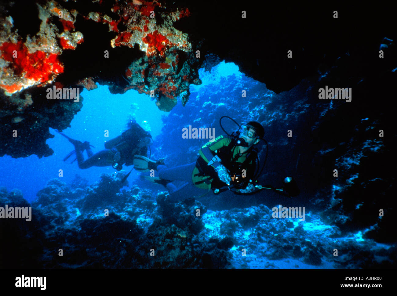 divers in underwater cave island of mwali comoros islands - Stock Image