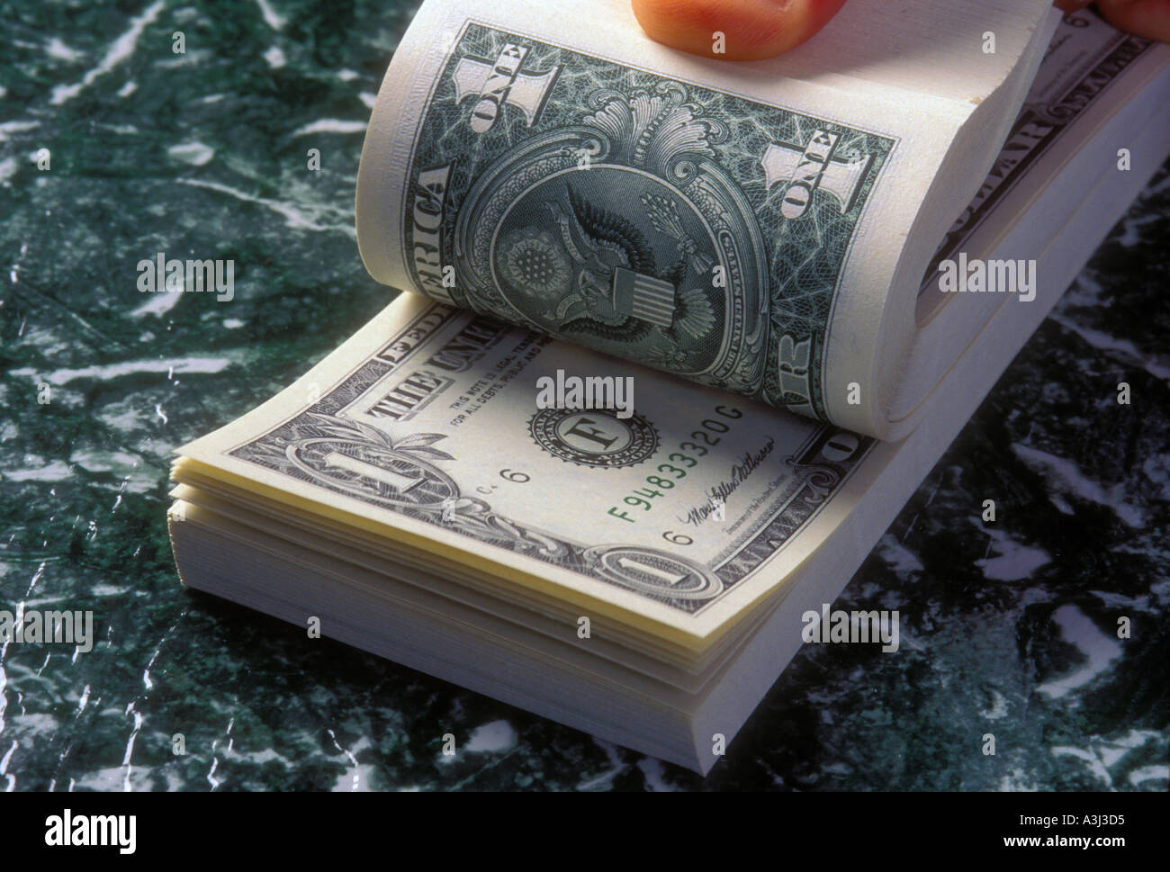 stack of one dollar bills US money - Stock Image