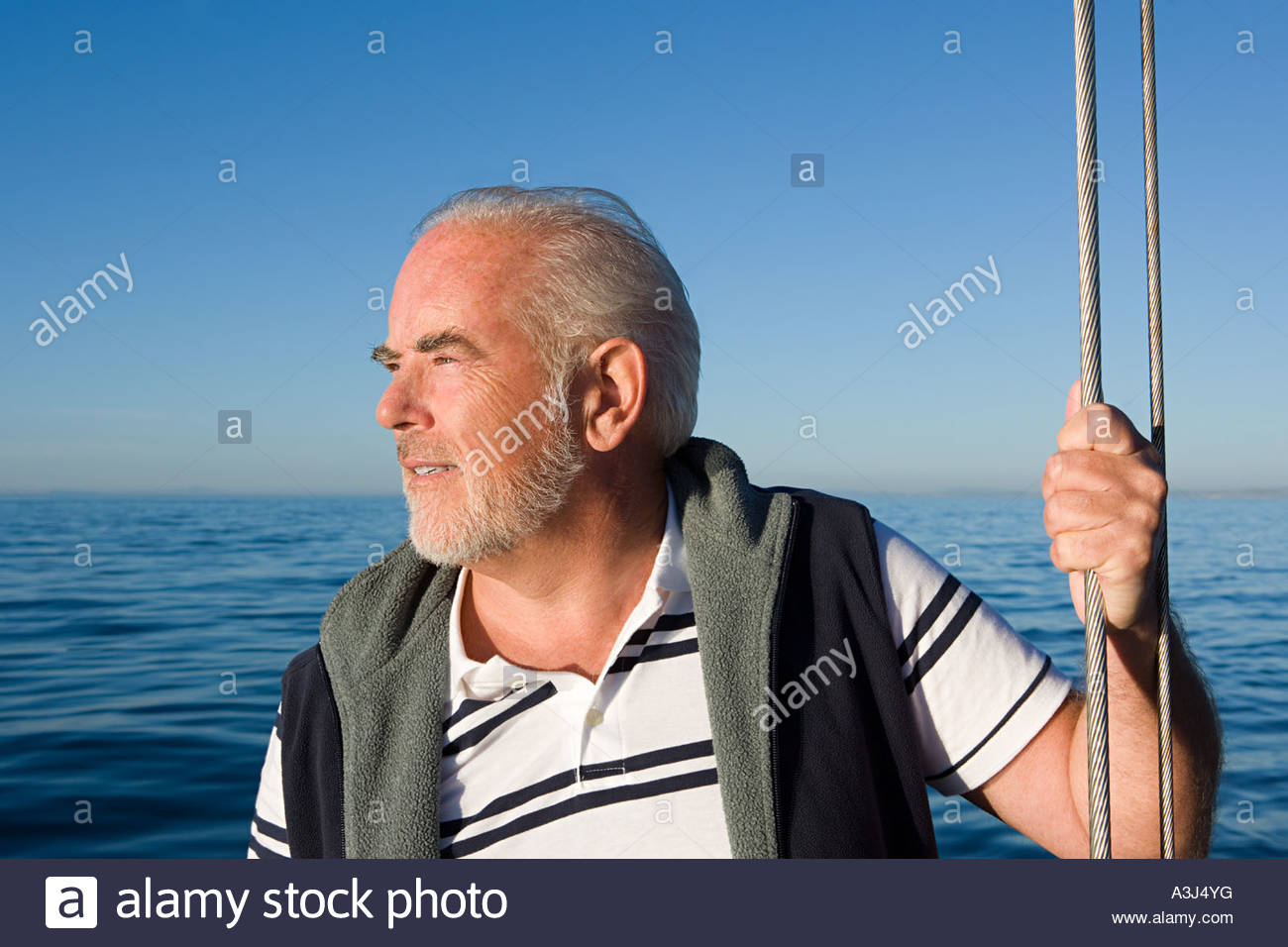 Man looking out to sea - Stock Image