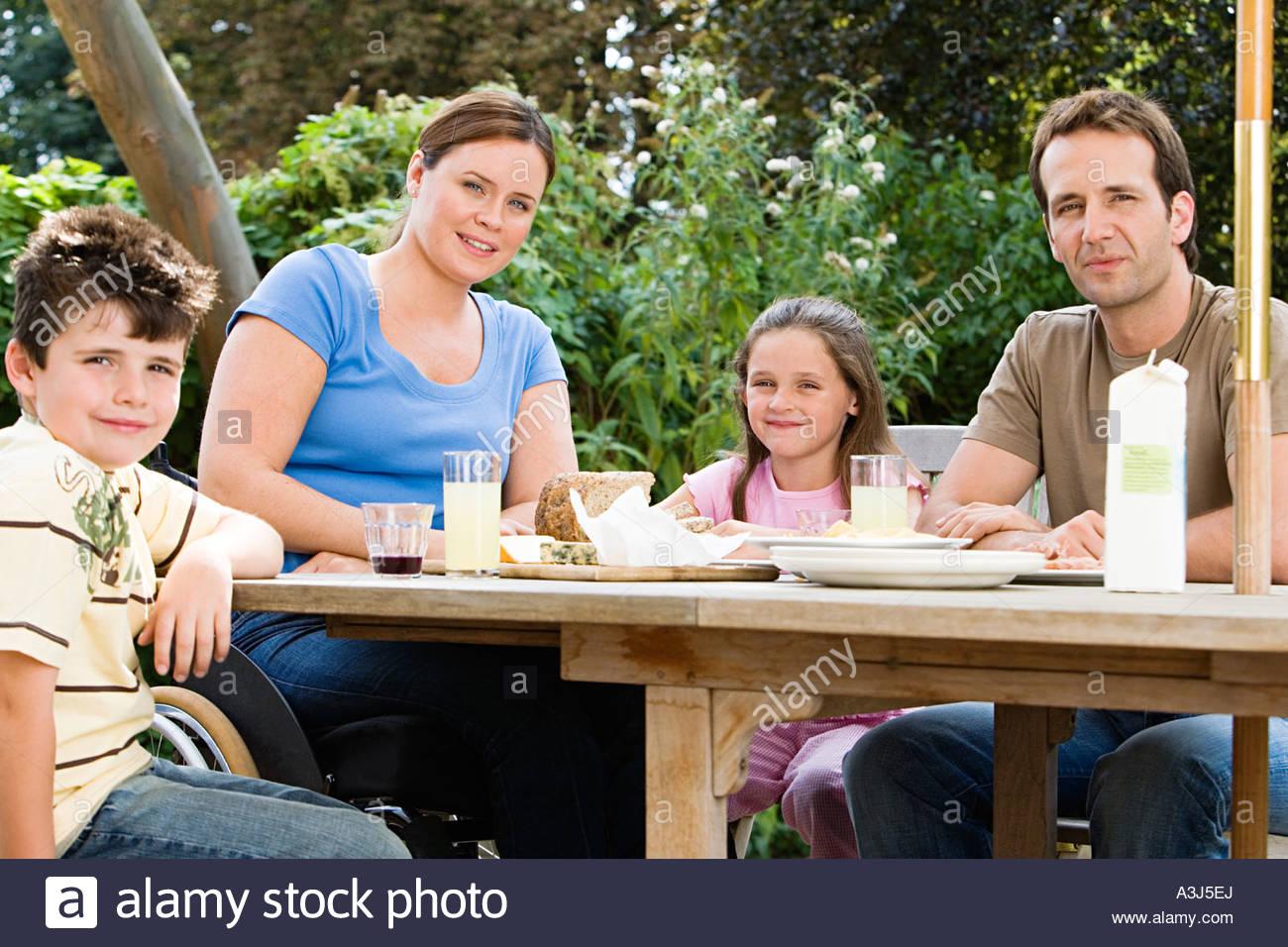 Familiy dining al fresco - Stock Image