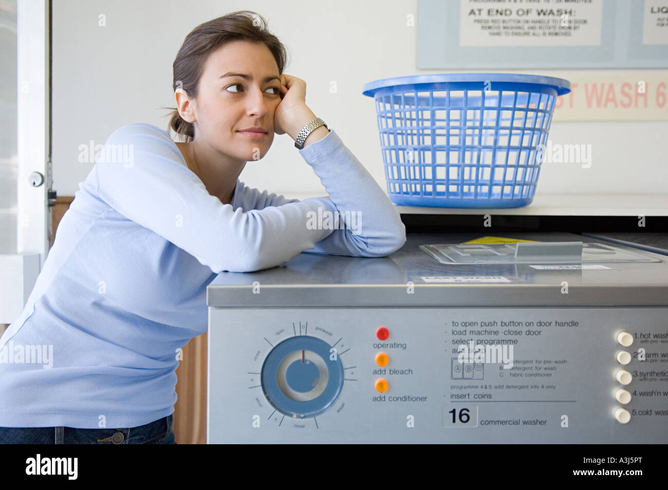 Woman in a laundrette - Stock Image