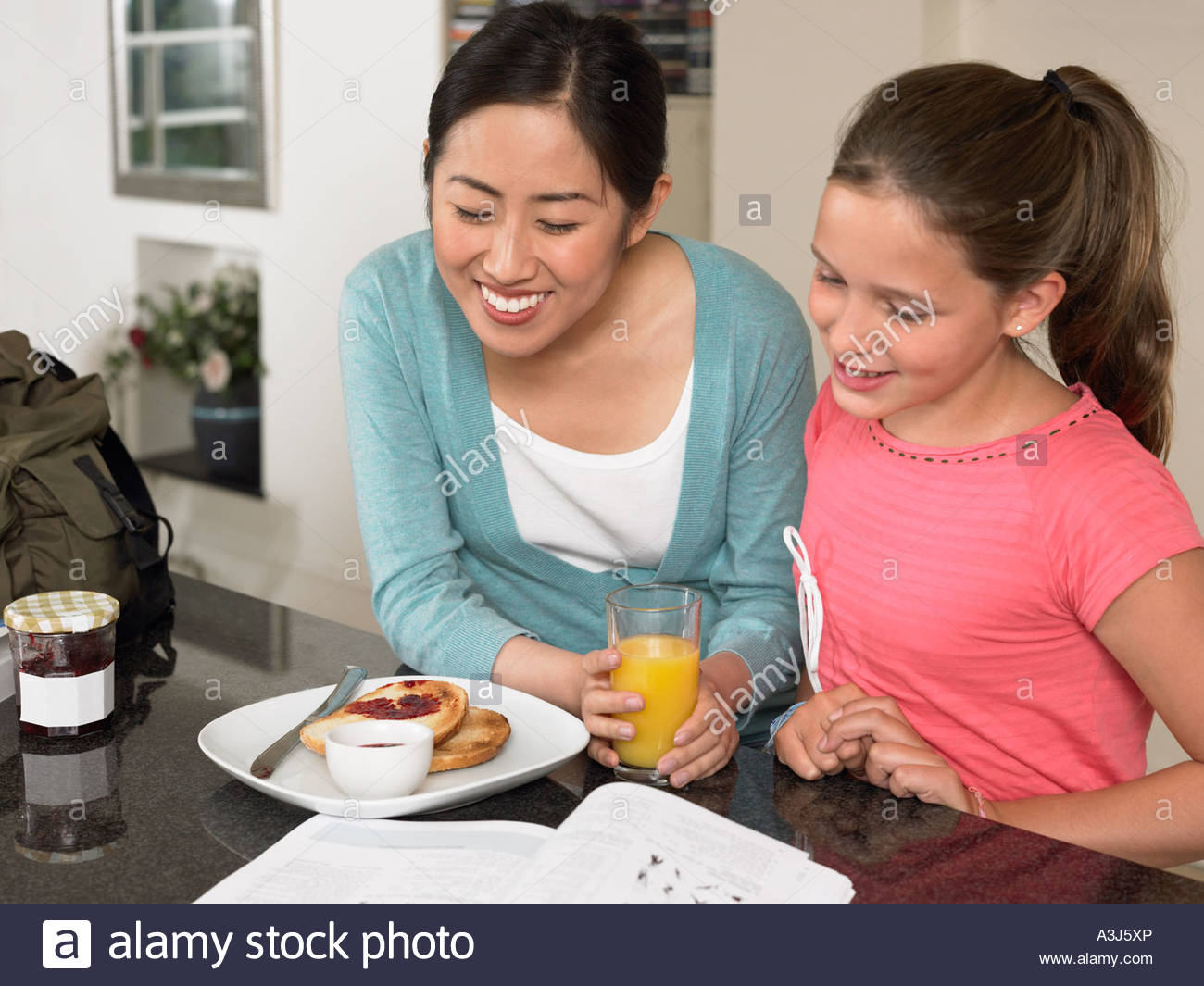 Exchange student and girl at breakfast - Stock Image