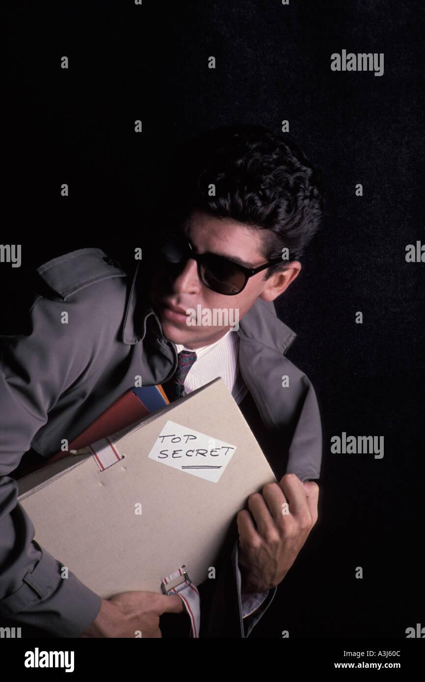Spy running away Stock Photo