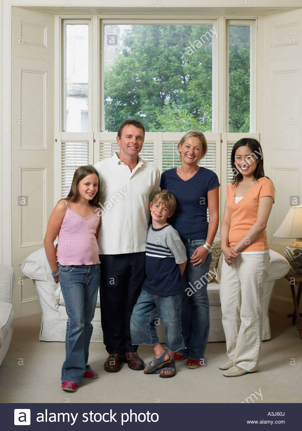 Japanese woman with english family - Stock Image