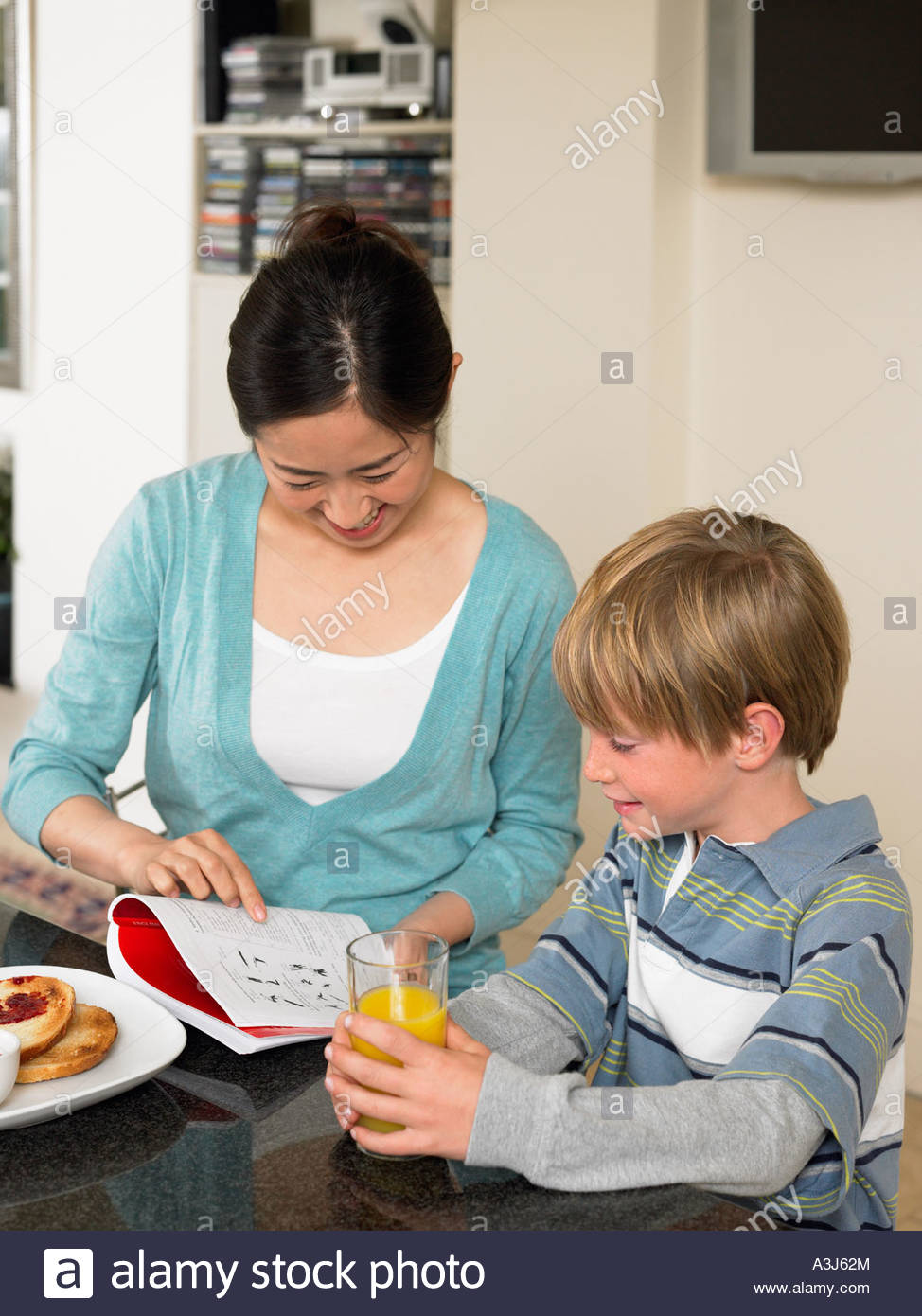 Exchange student and boy at breakfast - Stock Image