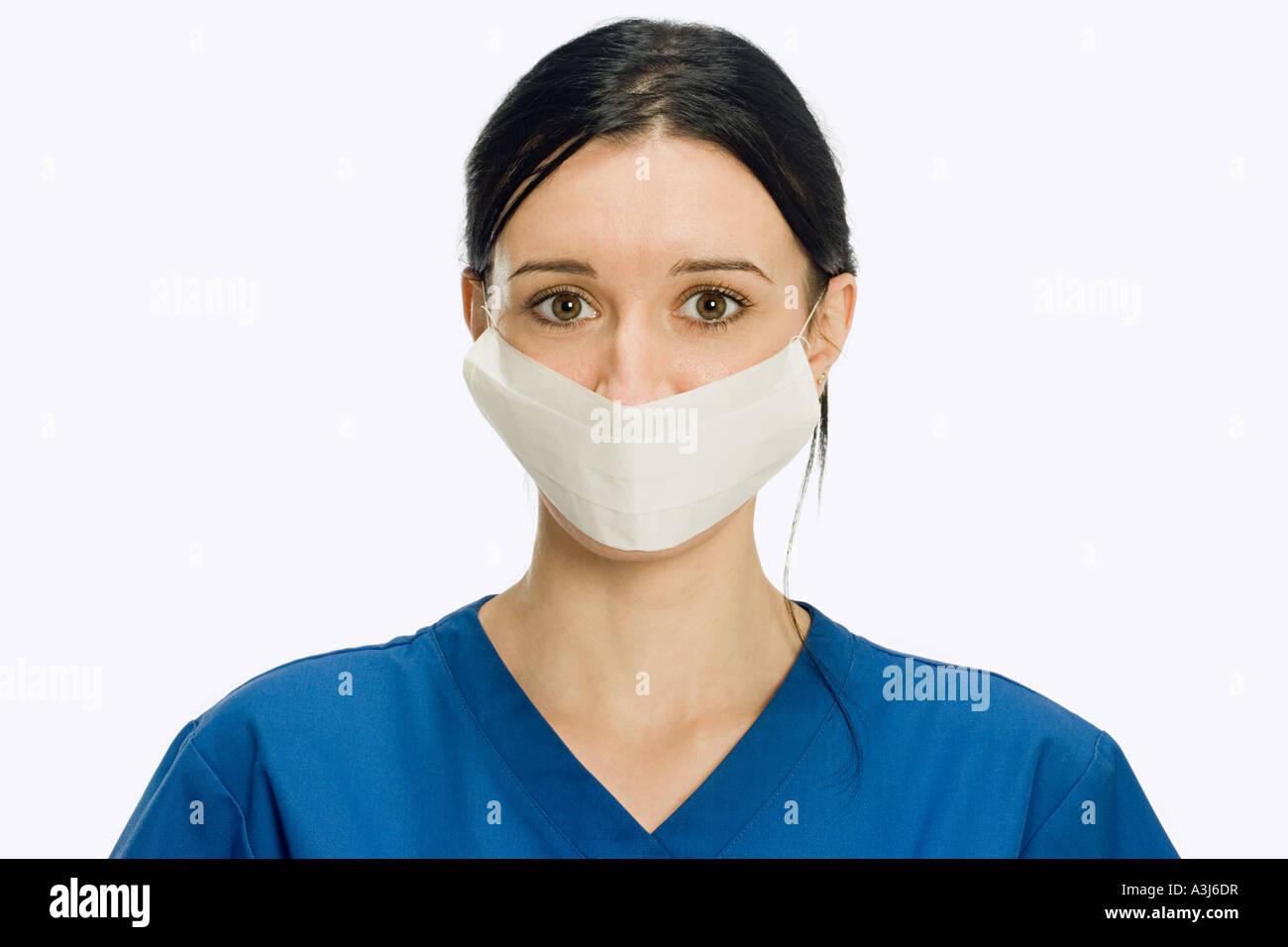 Surgeon wearing surgical mask - Stock Image